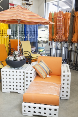 hassock: Variety of patio umbrellas and seating furniture in garden furniture store