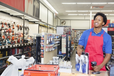 store clerk: African American male store clerk at checkout counter in super market