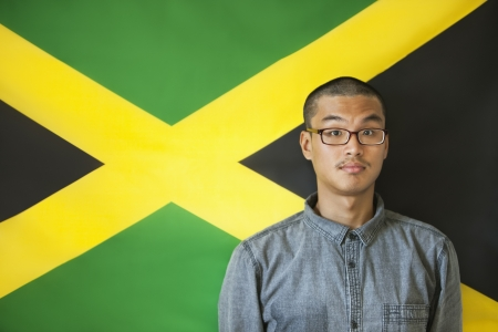 jamaican man: Portrait of a man with raised eyebrows against Jamaican flag