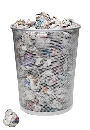 wastepaper basket: Wastepaper basket with papers lying over white background