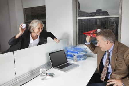 goofing: Side view of playful business colleagues in office LANG_EVOIMAGES