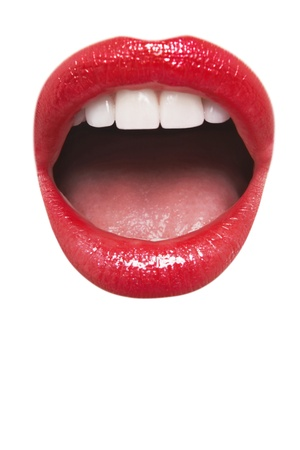Close-up view of female wearing red lipstick with mouth open over white background Stock Photo