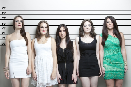 Portrait of five young women in a police lineup 版權商用圖片