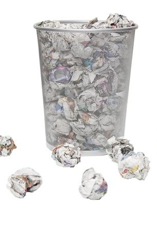wastepaper basket: Wastepaper basket with papers lying around over white background