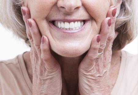 Close up view on senior dentures 写真素材