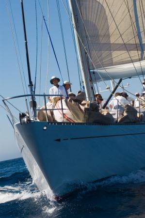 prow: Crew on sailboat on ocean