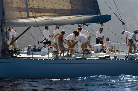 sailing crew: Crew working on yacht side view LANG_EVOIMAGES