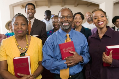 church worship: Sunday Service Congregation standing in church with Bibles portrait