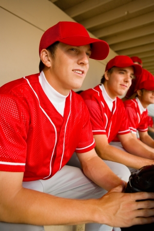 baseball dugout: Baseball team-mates sitting in dugout