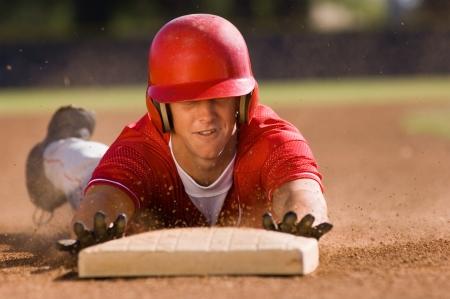 profess: Baseball player sliding into base LANG_EVOIMAGES