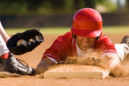 Baseball player sliding into base Standard-Bild