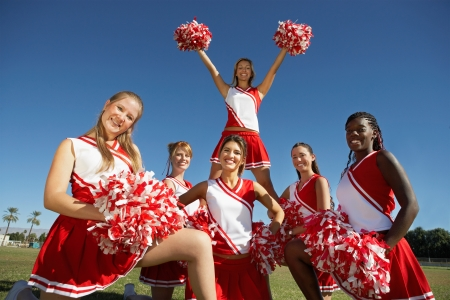 cheerleading squad: Cheerleading squad in formation on field portrait (portrait)