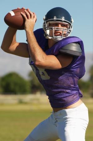 football object: Quarterback throwing ball on field portrait