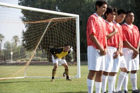 Soccer players preparing for free kick