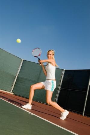 backhand: Tennis Player Hitting Backhand on tennis court
