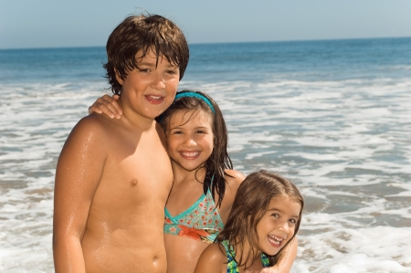 human's arm: Children in swimwear standing together by sea