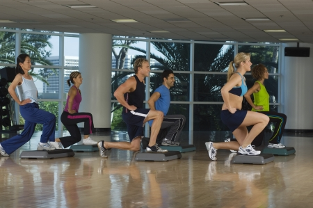 group fitness: People Exercising in Step Aerobics Class