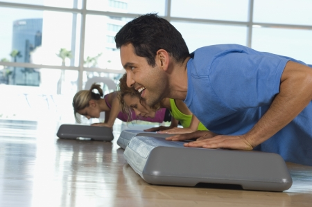 one person with others: People Doing Pushups in Exercise Class