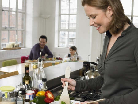 one person with others: Woman preparing salad in kitchen LANG_EVOIMAGES