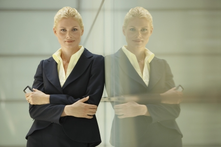 glass partition: Businesswoman Leaning Against Glass Partition