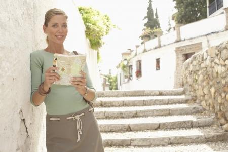 guidebook: Woman with Guidebook in Street