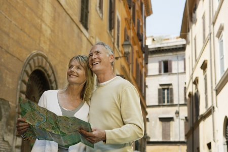 peo: Couple on street with map in Rome Italy low angle view LANG_EVOIMAGES