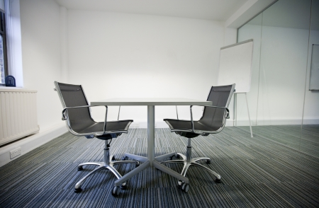 two chairs: Side view of small table and two chairs in office