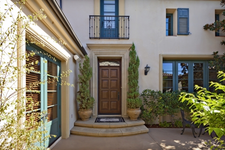 mediterranean home: Entrance to a beautiful Mediterranean home exterior LANG_EVOIMAGES