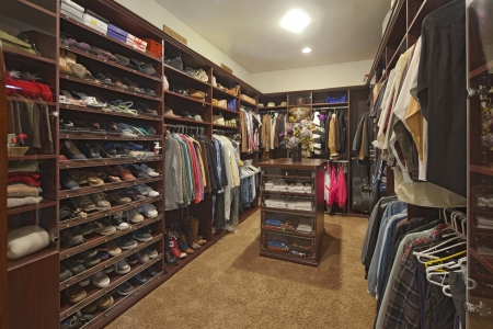 closet: Walk in closet with organized clothing