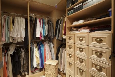 closet: Walk in closet with organized clothing