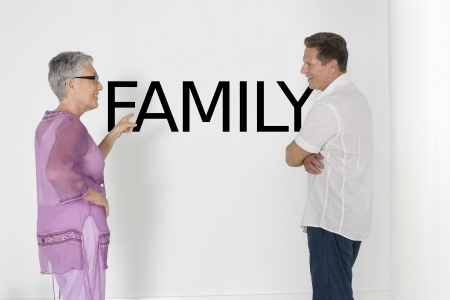 english text: Couple discussing family issues against white wall with English text