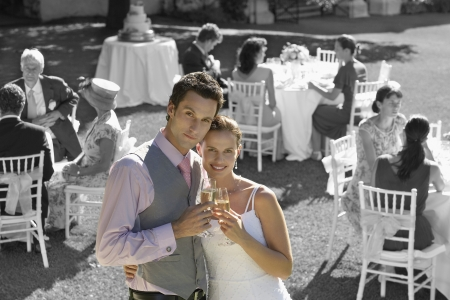 newly wedded couple: Portrait of newly wedded couple with champagne glasses at wedding reception