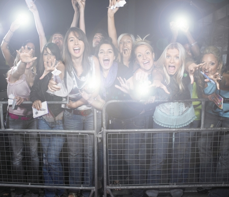 cheering fans: Crowd of young female fans screaming and cheering at concert