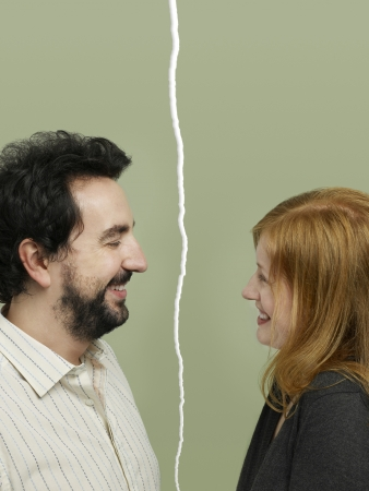 conflicting: Side view of mid-adult couple facing relationship difficulties