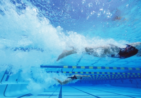 lane marker: Young Caucasian female swimmers swimming in pool