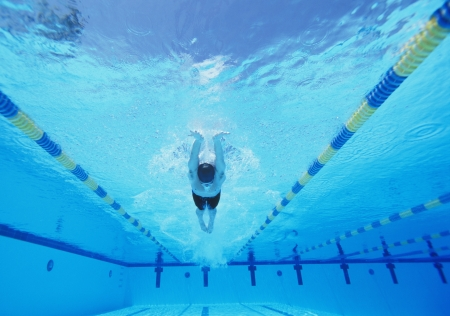 lane marker: Underwater shot of young male athlete swimming in pool