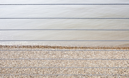 shingle beach: River Thames and Shingle beach behind wire rope fence