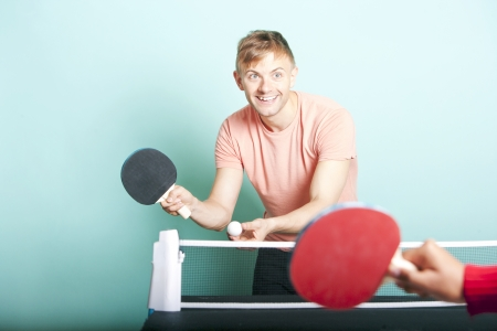 table tennis: Caucasian man playing table tennis with friend LANG_EVOIMAGES