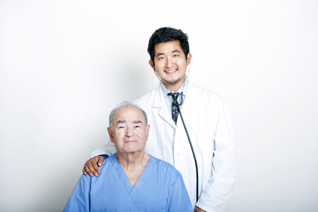 natural sciences: A young Asian Doctor with his hand on the shoulder of a Senior adult patient