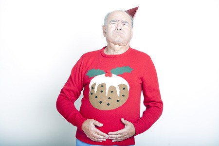 christmas pudding: Senior Adult Man indicating that he is full up