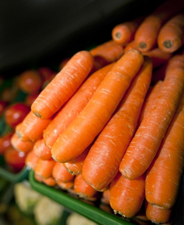 commercialism: Close-up of fresh carrots in supermarket