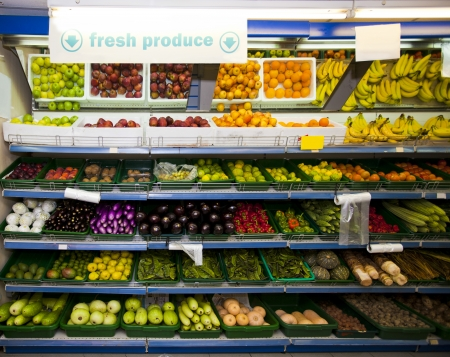 commercialism: Various vegetables and fruits on display in grocery store