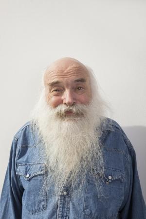 man in jeans: Portrait of senior man over gray background LANG_EVOIMAGES
