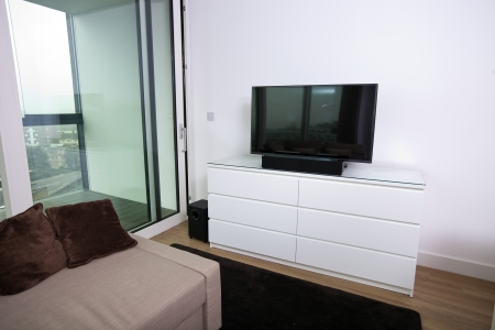Interior of apartment with flat screen television Stock Photo - 25294717