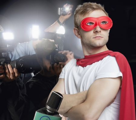 incidental people: Superhero being photographed by paparazzi
