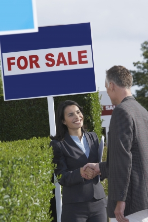 business for the middle: Real Estate Agent and Client Shaking Hands