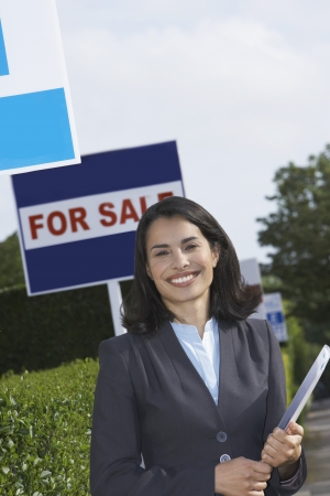Smiling Real Estate Agent Outdoors Stock Photo
