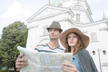 casimir: Tourist couple holding map outside St. Casimir Church; Warsaw; Poland