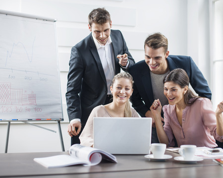 business casual: Successful young business people using laptop in meeting