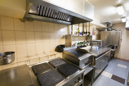 tiled stove: Interior of empty restaurant kitchen
